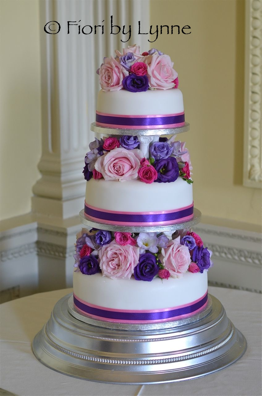 wedding cakes with pink and purple flowers wedding flowers pippa s bright and beautiful wedding 26083
