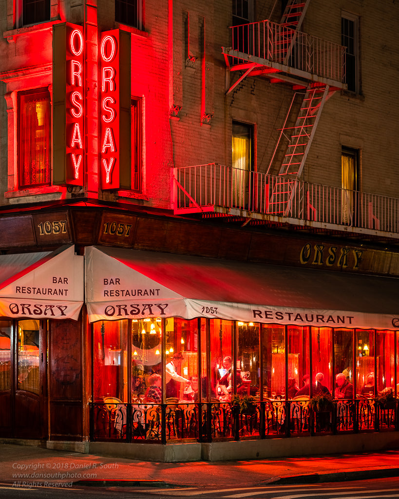 a photograph of restaurant orsay in new york city at night