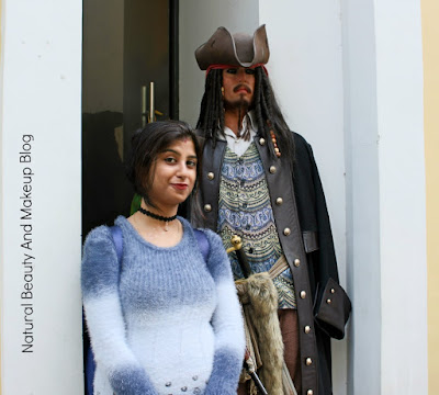 With wax statue of Johnny Depp , Jack Sparrow (Caribbean of Pirate film actor) at 3D Animation and Celebrity Wax Museum, Macau