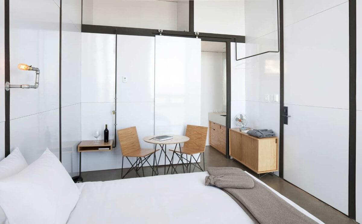 06-Seating-Area-and-Bathroom-Gracia-Studio-Cabin-Architecture-set-on-a-Hill-www-designstack-co