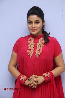 Actress Poorna Latest Stills in Red Dress at Rakshasi First Look Launch  0056.JPG