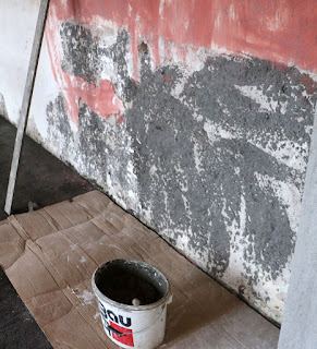 Ready to put the final cement on these damaged areas of wall