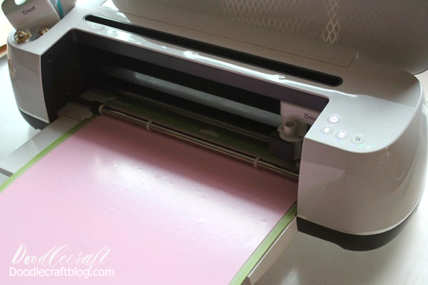 Cricut Maker cutting out heat transfer vinyl iron-on.