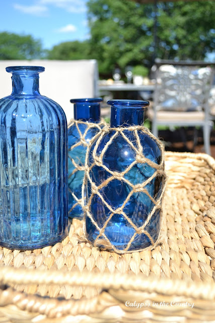 Blue Coastal Bottles and other accessories to decorate your deck for summer