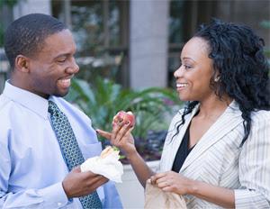black-man-woman-smiling-crushing-outside