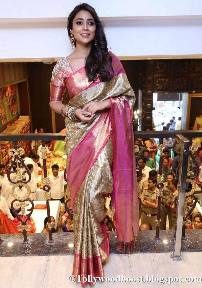 Shriya Saran At VRK Silks Launch In Traditional Yellow Saree