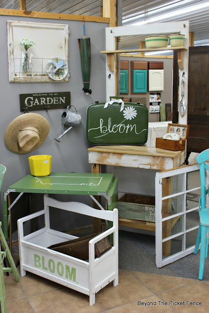 vintage suitcase makes a cute sign for a porch