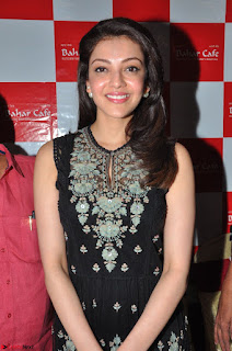 Kajal Aggarwal in lovely Black Sleeveless Anarlaki Dress in Hyderabad at Launch of Bahar Cafe at Madinaguda 019.JPG