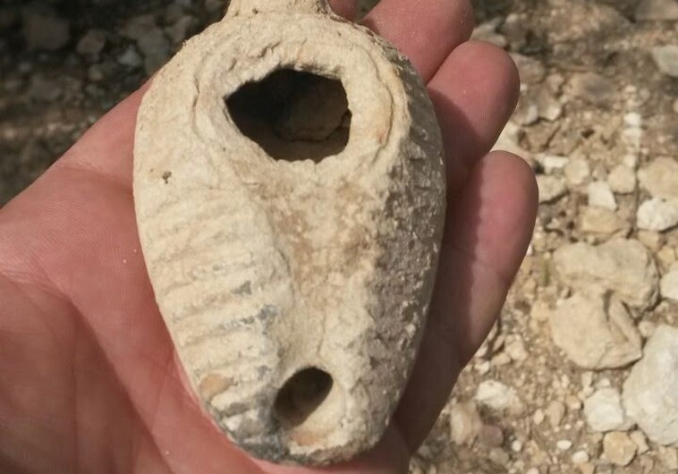 Porcupine unearths 1,400 year old oil lamp
