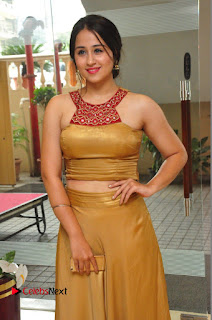 Actress Simrat Juneja Pictures in Golden Long Dress  0041.JPG