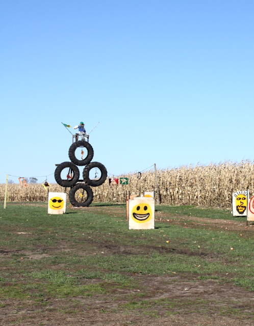 Having fall farm fun with the apple cannon at Skelly's Farm Market in Janesville, Wisconsin.