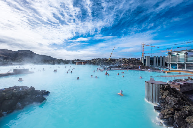 Bathers soaking in the Blue Lagoon on a Day Trip from Keflavik Airport
