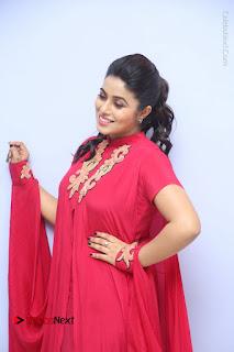 Actress Poorna Latest Stills in Red Dress at Rakshasi First Look Launch  0074.JPG