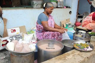 A woman selling Raagi Malt