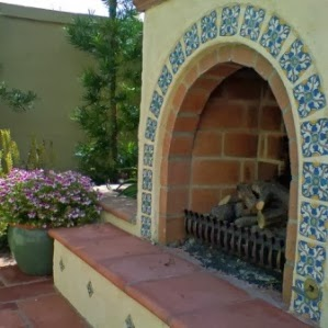 Spanish ceramic tile outdoor fireplace