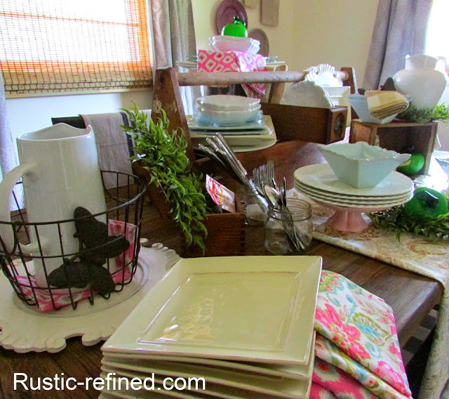 Barnwood, antiques and dishes used for a rustic centerpiece idea