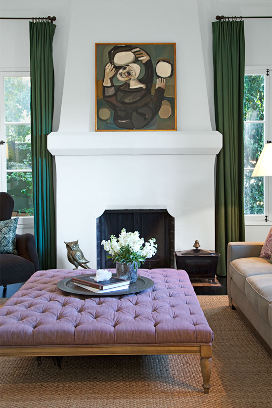 A large square lavender ottoman matches beautifully the emerald pops in the living room of Ginnifer Goodwin. Photo by Hilary Walsh via Elle Decor.