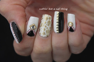 Black, gold and white nail art