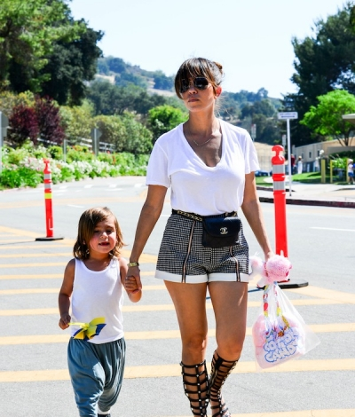 f1a0d78befe79f Kourtney Kardashian Wearing Black and White Shots with Gladiator Sandals