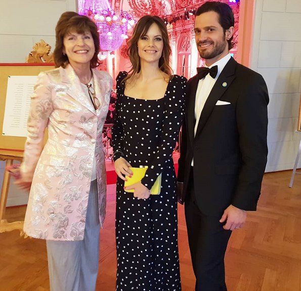 Princess Sofia wore a Ruched polka dot maxi dress by &Other Stories and Ida Sjöstedt Antonia coat. Duchess of Cambridge wore the same coat