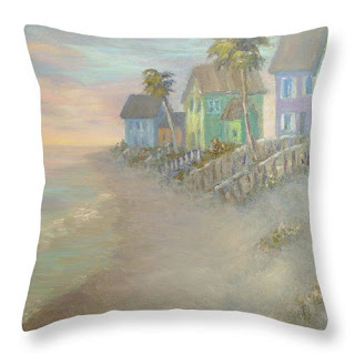 Beautiful coastal throw pillow of a beach with cottages by the sea