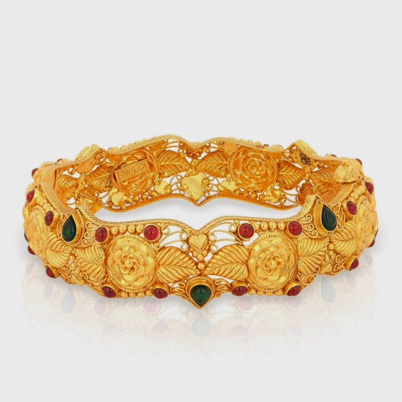 Jewellery Designs Latest Gold Bangle with rubies and emeralds