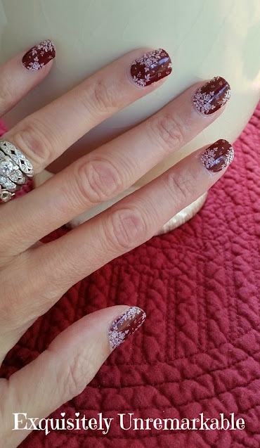 Red floral nail wraps on hand