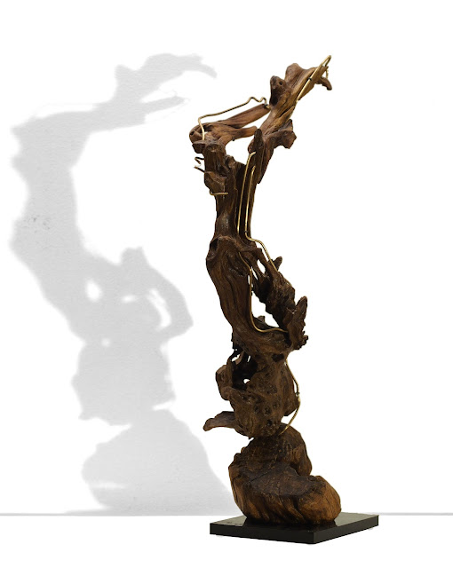 Winged Victory of Samothrace, driftwood art sculpture with bronze details.