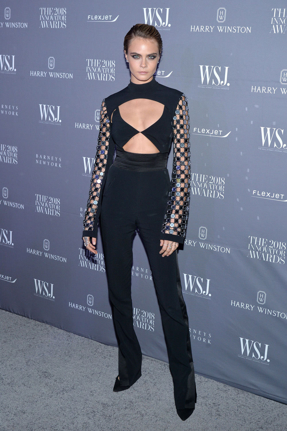 Cara Delevingne is blonde bombshell in backless black outfit featuring torso cutouts at Innovator Awards