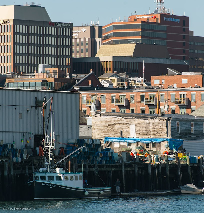Portland, Maine USA October 2017 photo by Corey Templeton. A compressed perspective of Portland's banking district looming over the working waterfront and Custom House Wharf.