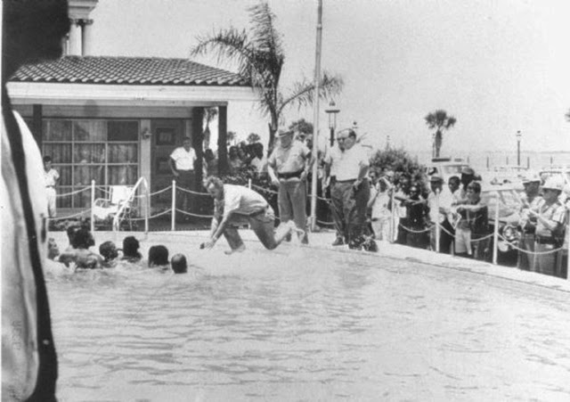 A Photo Series Captured A Motel Manager Pouring Acid Into Pool To Drive Black People Out In 1964