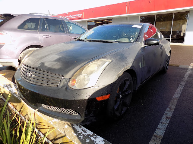 Faded Infiniti G35 before getting painted at Almost Everything Auto Body.
