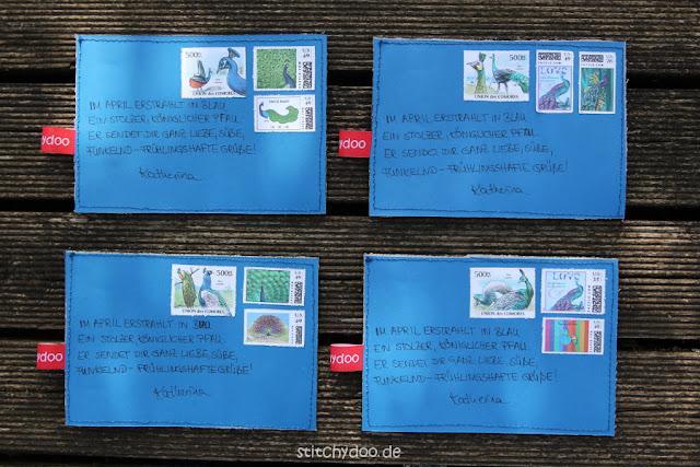 stitchydoo: Jeansrecycling Stoffkarten - Die Rückseite zieren Pfauenbriefmarken