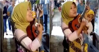Pengamen Gendong Bayi Ini Viral, Netizen Terpesona dengan Suara Merdunya