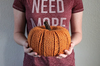 knit pumpkin in a woman's hands