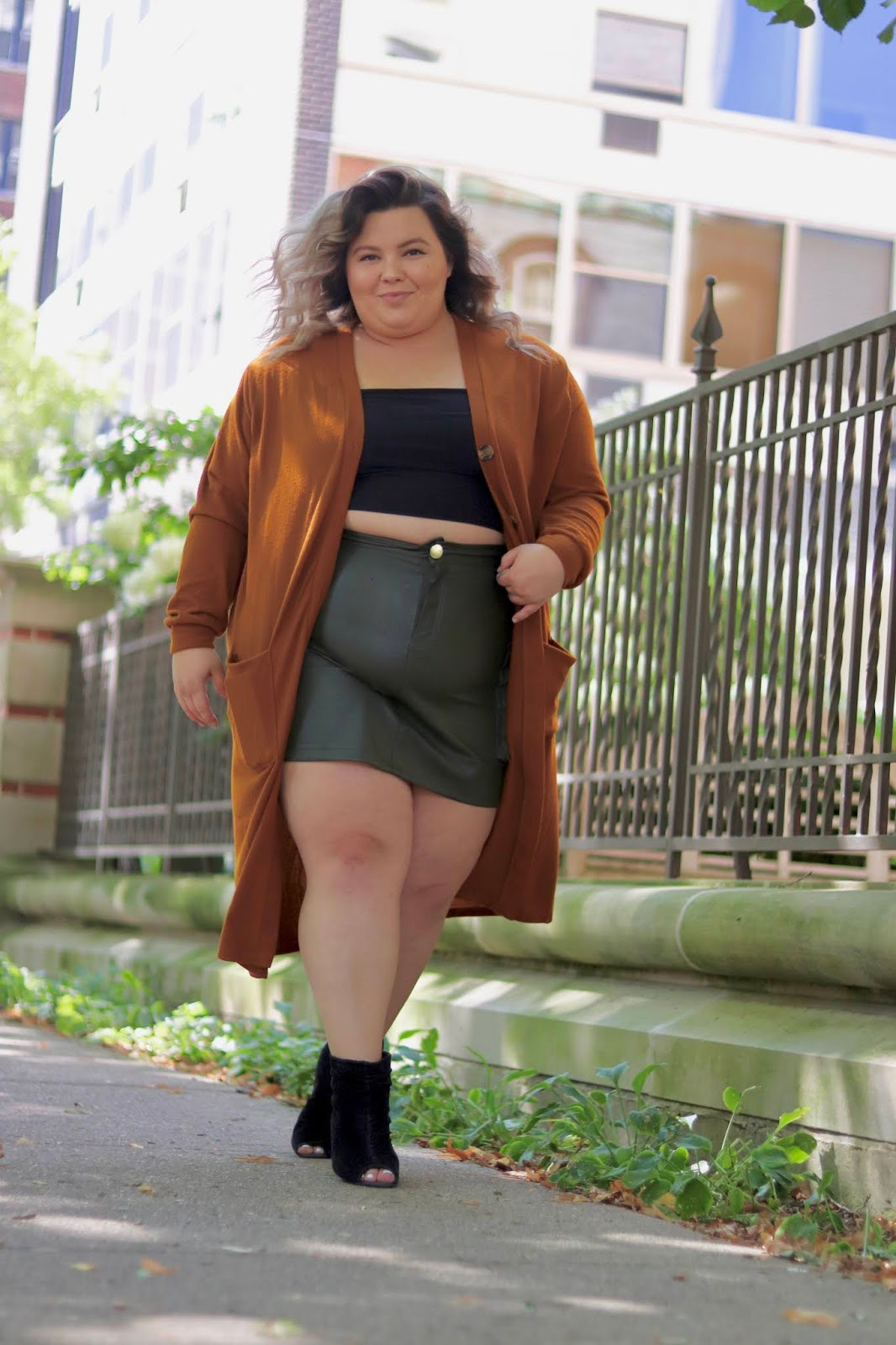Chicago Plus Size Petite Fashion Blogger, influencer, YouTuber, and model Natalie Craig, of Natalie in the City, reviews Fashion Nova's fall 2019 clothes including cardigans and skirts.