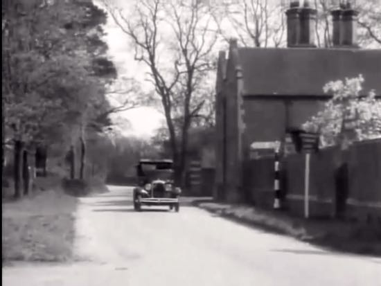 Dr Smart-Alec arrives at Narkover in the film Boys Will Be Boys (1935)  Screen grab from film by North Mymms History Project