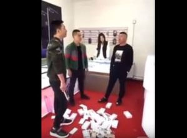 Too Much Money!! Man Buys And Destroys 15 Iphones After Attendant Insulted Him (See Video)