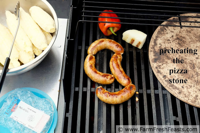 grilling the toppings and preheating the grill stone to make grilled sausage and peppers pizza