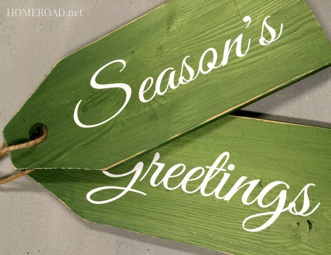Green wooden tags with stenciled Season's Greetings