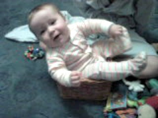 Baby Sitting in Basket Smiling