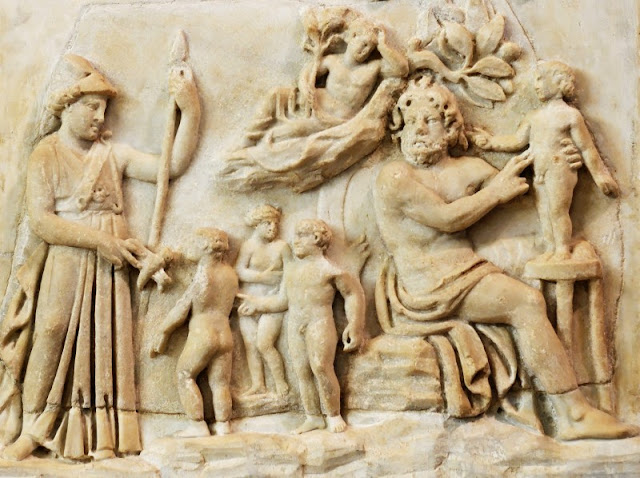 Prometheus creating man from dirt, helped by Athena.