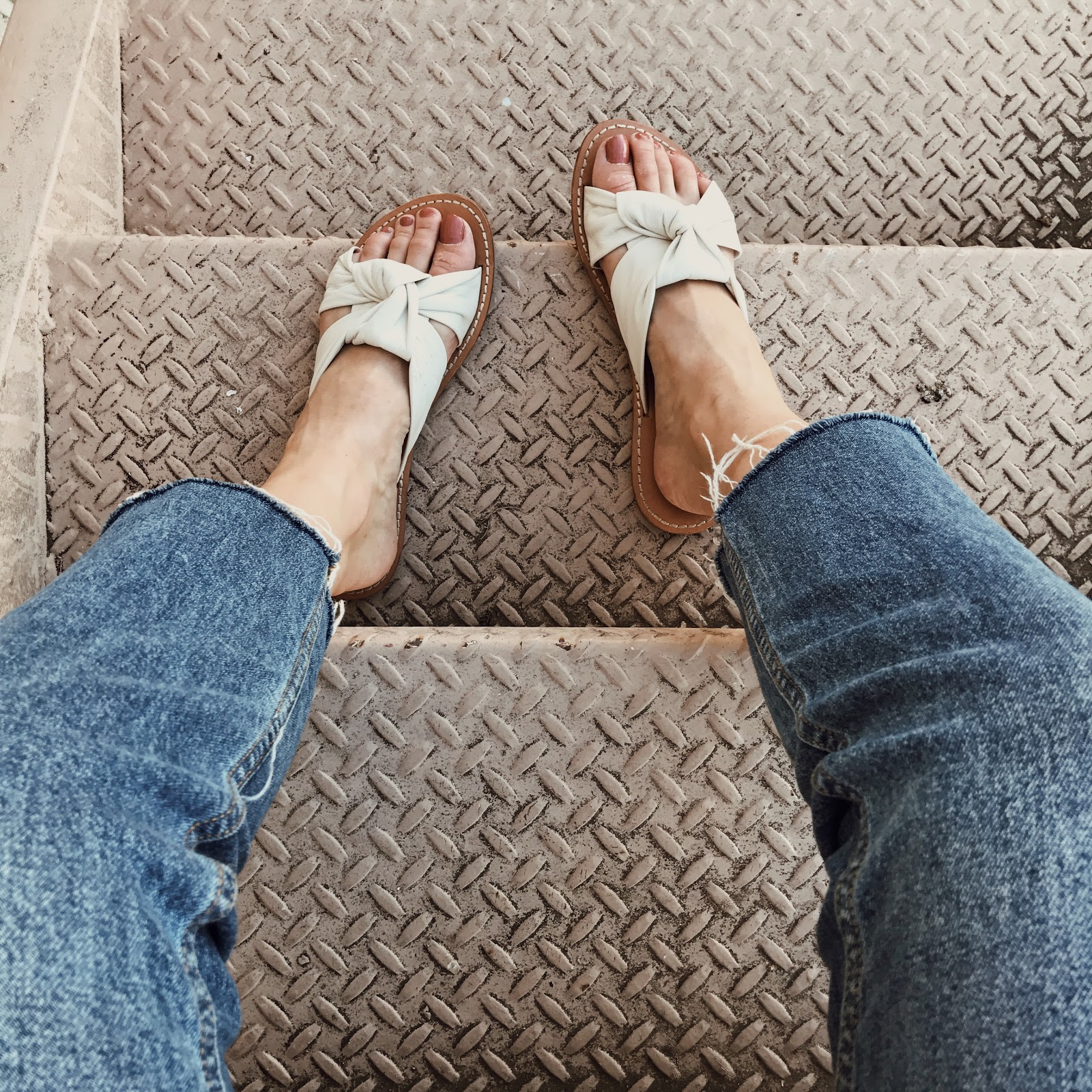 white leather slide sandals