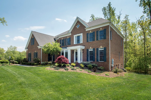 Open House - Home For Sale 12806 Rose Grove Dr, Herndon, VA 20171  Price: $1,349,000 4 Bedroom, 4.5 BathFull Brick Colonial on  . 83 acres Magnificent Winchester Homes Expanded Randall Model Home in the Sought after Oak Hill Reserve Community. You'll know as soon as you've walked into the Randall that you've come across something special. The grand foyer greets you with an elegant staircase winding up to the second floor. To each side are the spacious Living Room and Dining Room for formal entertaining. Through the foyer, a library provides quiet space and comfort for a home business or relaxing hideaway. Beautiful kitchen cabinetry and the eating bar accent the Magnificent Atrium Kitchen. Handsome granite counters complete the kitchen ensemble. The large breakfast room faces the rear yard for a wonderful open wooded lot with a nature view. Adjacent to the kitchen is a magnificent two story family room with a dual glass gas burning fireplace, ideal for informal gatherings and a Solarium to enjoy the great indoor outdoor throughout all seasons.  A dramatic stairway leading to the upper level provides a grand view of the family room from the balcony. The master suite is a private elegant retreat on one side of the upper level, and a princess suite is tucked into the opposite side of the second floor. The inviting master suite has a luxury master bath with a soaking tub, separate shower, and private water closet. Updated Two secondary bedrooms with a buddy bath complete the second floor.  The lower level is designed for comfort, and relaxation, with an expansive recreation room, exercise room, media room and storage.  The recreation room offers a full bath with Steam Shower and walk-out access to the stone patio in the rear yard.   The exterior offers grand curb appeal, large deck off kitchen and Sun Florida Room, extensive landscaping,  covered portico with brick stoop, 3 car side loading garages with auto door opener.  Convenient to Route 50, 66, 29, Fairfax County Parkway, Fair Oaks Mall, Reston Town Center and Fair Lakes Shopping, Golfing, and Fair Oaks Hospital.  This home is serviced by Crossfield Elementary School, Carson Middle School, and Oakton High School.