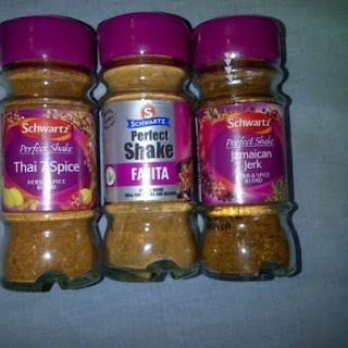 Jars of Schwartz Perfect Shake's seasonings in Jamaican Jerk, Fajita and Thai 7 spice.