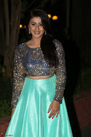 Nikki Galrani in Green Skirt  Top at Marakathamani music launch ~  Exclusive (26).JPG