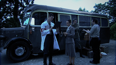 The grey 'murder-box' bus © Roaring Girl Productions