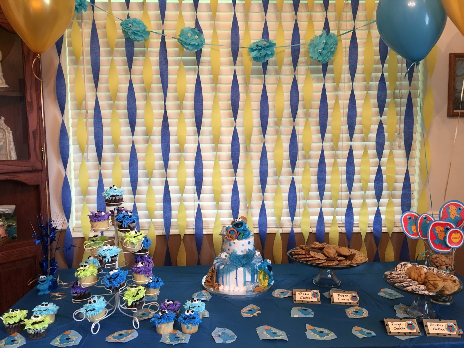 I had so much fun with the decorations! I did Cookie Monster blue and gold crepe paper down the window then after I\u0027d fluffed out the crepe paper balls ... & Julie Coulter Bellon: How I Did A Cookie Monster Baby Shower