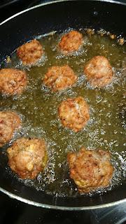 chicken balls frying in oil