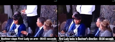 Boehner slaps First Lady's arm.